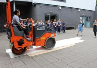 Teacher Riana Guttridge using the Selwood Ride On Roller supplied by the Bristol branch