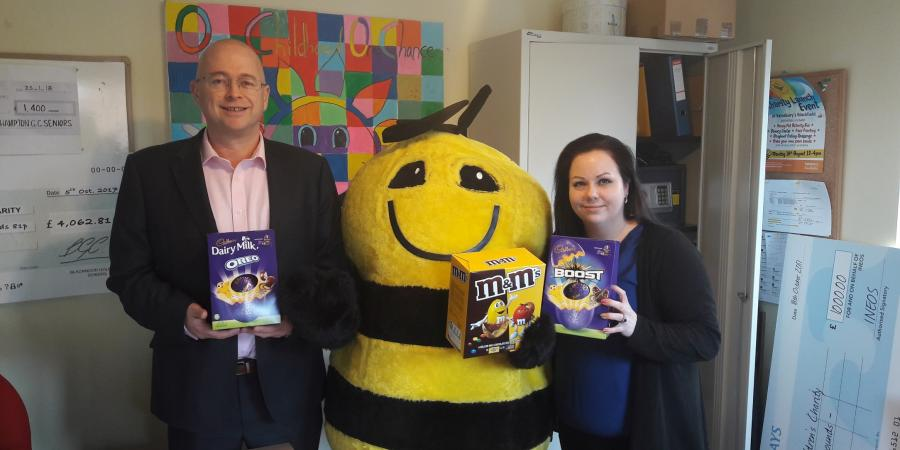 "Richard Brown, Managing Director – Pumping Solutions at Selwood, Honeypot mascot ""Bumble"", and Kate Browning, Regional Fundraising Manager"